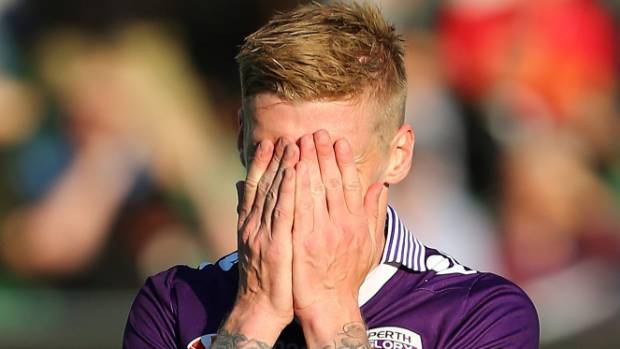 Perth Glory's Andy Keogh reacts after missing a penalty against the Wellington Phoenix at Nib Stadium on Sunday.
