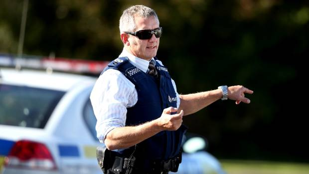 Detective Senior Sergeant Blair Burnett at a cordon during an armed police call out in Inglewood in 2015.