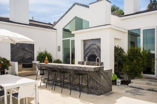 Highly patterned marble is used in the outdoor kitchen.