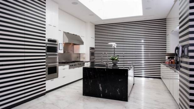The kitchen, like the rest of the home, is decorated in black and white.