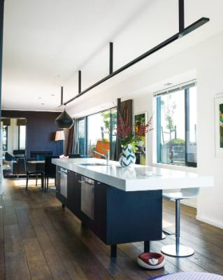 The kitchen is perfectly positioned to have light and sunshine most of the day and into the evening; the stools and Tom ...