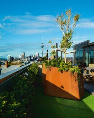 The huge, asymmetrical Corten steel pots on the terrace were designed by Colin and Lindy and made by Stainless Steel ...