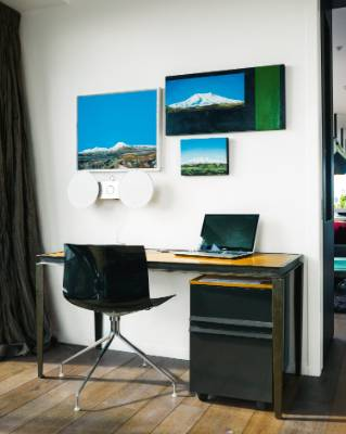 The couple's youngest son Luke was responsible for the three paintings of Mt Ruapehu in the study.