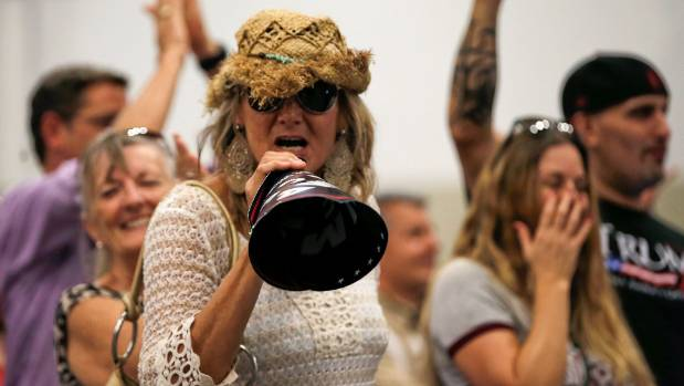A Trump supporter screams at members of the press at a campaign rally in West Palm Beach, Florida.