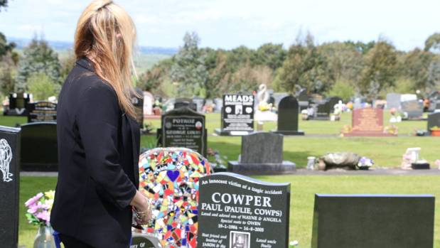 Angela Chamberlain at her son Paul's graveside in Hawera Cemetery. It is close to other  family members and the friends ...
