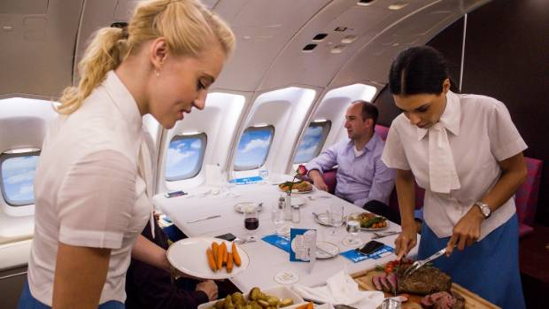 Stewardesses who carve the Chateaubriand steak or fork over a chicken breast, along with vegetable and roast potatoes, ...