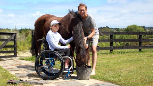 Holly Pretorius with dad David and her horse Myra.