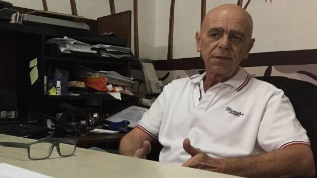 Jack Walker, head of an American veterans' association, speaks in his office in Olongapo city, Philippines.