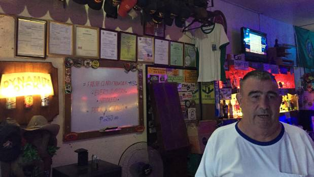 Former US marine Richard Haulet, 64, in his Olongapo city bar, which is frequented by other American veterans.