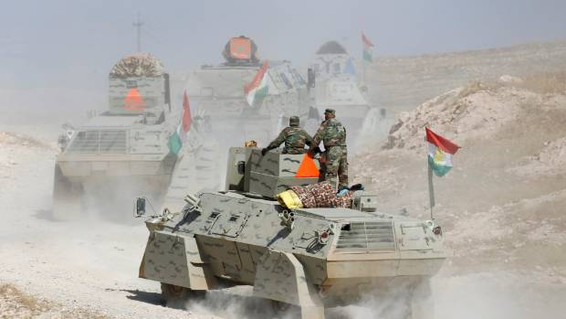Peshmerga forces advance in the east of Mosul to attack Islamic State militants in Mosul, Iraq.