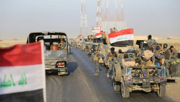 Iraqi security forces advance in Qayara, south of Mosul, to attack Islamic State militants in Mosul, Iraq.