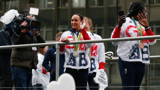 Heptathlete Jessica Ennis-Hill waves to the crowd during the British Olympic team's homecoming parade in Manchester.