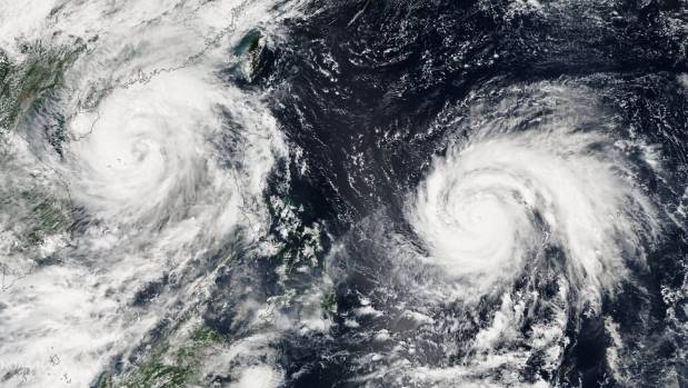 Typhoon Sarika, left, now a tropical storm, killed two in the Philippines last week. Now upgraded Super Typhoon Haima, ...