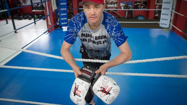 Dion McNabney, owner/operator of Nabby's Boxing and Fitness Gym where Neville Knight trained, holds a pair of boxing ...