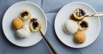 Old-school rice pudding gets a glamorous makeover in these vanilla-infused arancini with oozing dark chocolate centres.