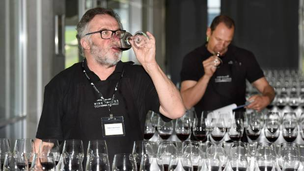 Australian judge Ralph Kyte-Powell tastes a line-up of pinot noir at Air New Zealand Wine Awards judging in Auckland.
