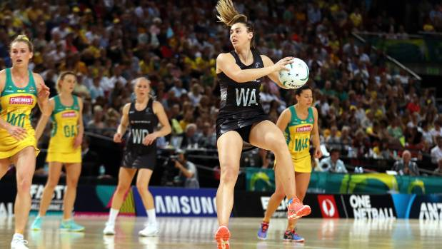 Gina Crampton takes the pass for the Silver Ferns against the Australian Diamonds in Sydney.