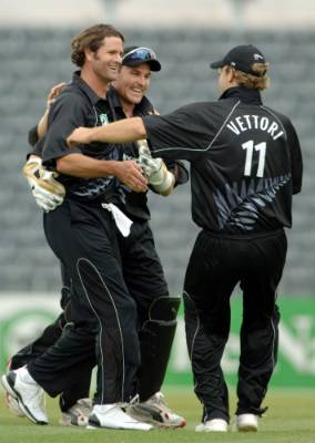 Chris Cairns, left, is congratulated by team mates Brendon McCullum and Daniel Vettori during happier times.