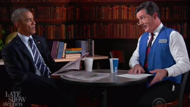 Obama being put through his paces by a mustached job interview expert, played by Colbert.