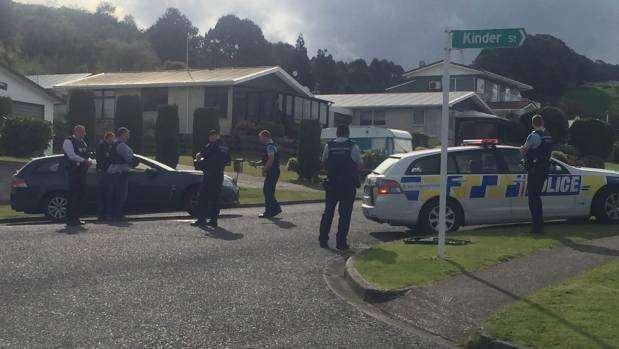 Police are responding to an armed incident. Cordons are in place on Reeves Road, Acacia Bay.