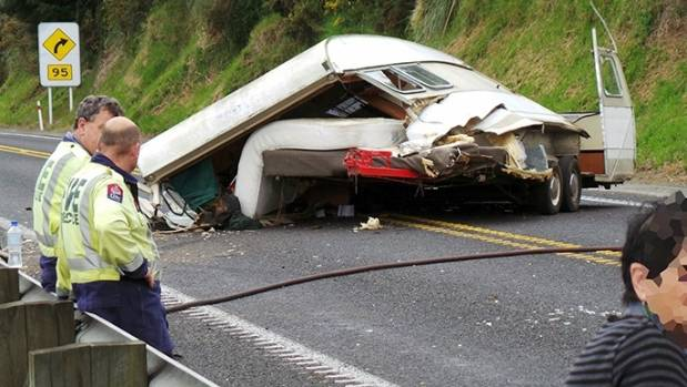 A caravan blocked two lanes of State Highway 2 after it flipped onto its roof between Barrett and Youngson roads on ...