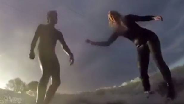 Surf instructor Peter Abell, got down on one knee and popped the question to his marine biologist partner Angie de Burgh ...