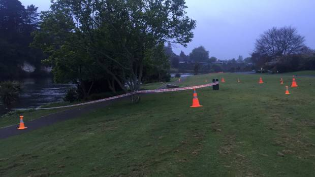 Police tape surrounds the location where a woman's body was found in the Waikato River.