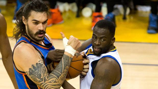 Oklahoma City Thunder centre Steven Adams and Golden State Warriors forward Draymond Green couldn't be separated when ...