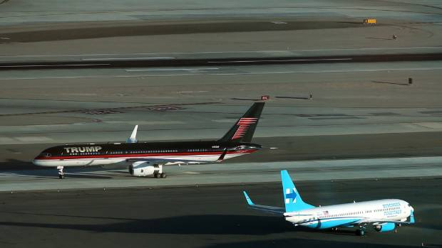Republican presidential nominee Donald Trump's campaign plane (rear) passes Democratic presidential nominee Hillary ...