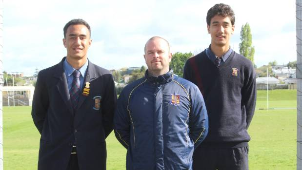 Jirah Momoisea, left, with St Paul's College rugby league coach Dave McDermott and brother Rocky.