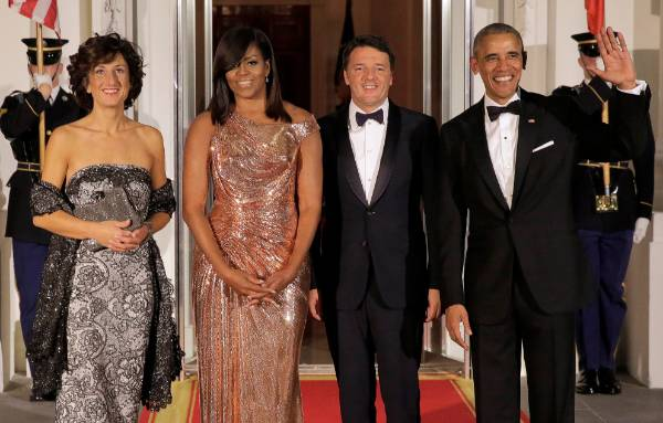 This Versace gown literally made headlines. What a triumph. The Obamas are pictured here with Italian prime minister ...
