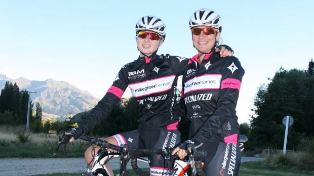 Siblings Mikayla and Cassandra Harvey in their Black Magic Women cycle team kit.