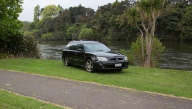 A black Subaru was found parked next to a tree on the river bank on the Ann Street reserve.