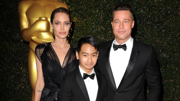 Angelina Jolie, Maddox Jolie-Pitt and Brad Pitt at the post-Oscars Governor's Ball in 2015.
