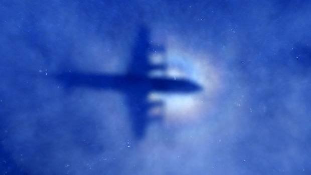 A Royal New Zealand Air Force aircraft flies over the southern Indian Ocean looking for missing Malaysian Airlines ...