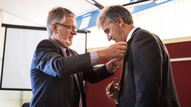 Tasman District Council chief executive Lindsay McKenzie places the mayoral chains around re-elected mayor Richard ...