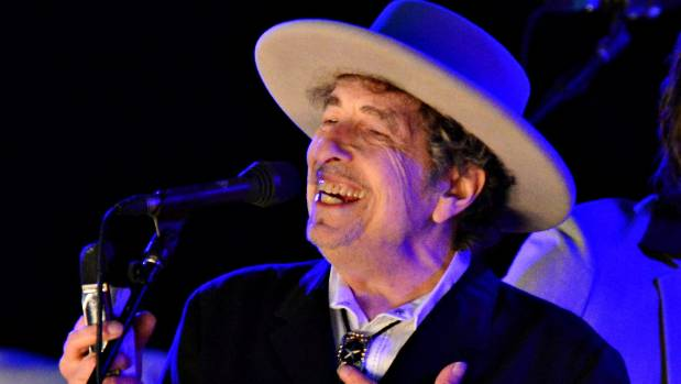 "Bob Dylan says he wishes he could pick up his Nobel Prize in person but he has ""other commitments""."