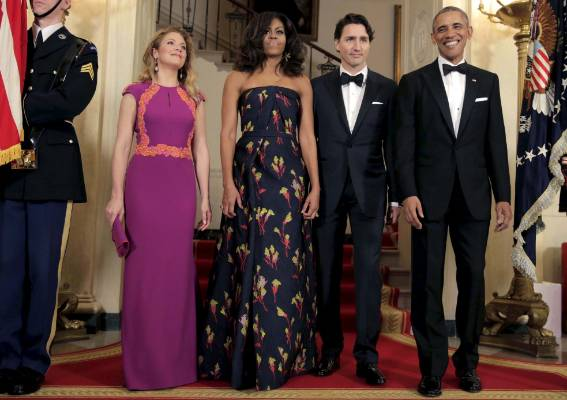 Pictured here with Canada's Prime Minister Justin Trudeau and his wife, Sophie Gregoire, Michelle is wearing Jason Wu. ...
