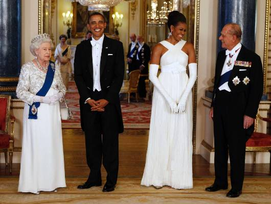 Please join us across the pond (from the States, that is) at Buckingham Palace. Michelle is wearing Tom Ford, and I can ...