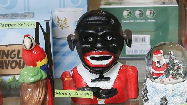 The money box is a knock-off of a racist money box from a bygone era.