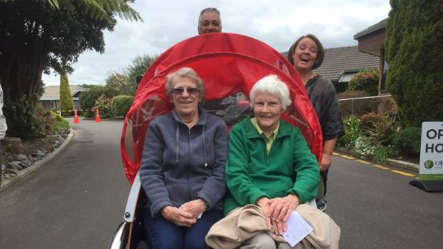 Olive Tree residents Betsy Bruere and Helen Holterman with Dorthe Pedersen from Cycling Without Age, and pilot Mike ...