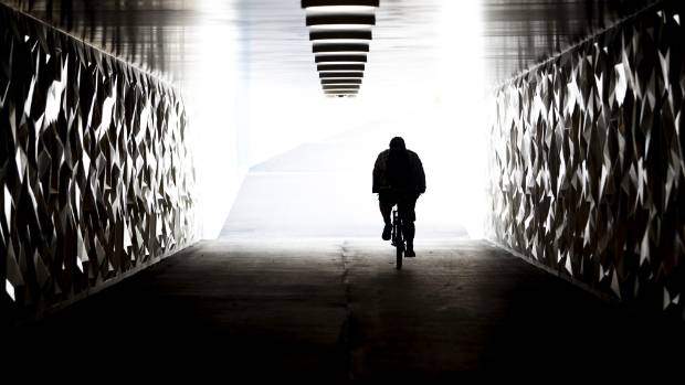 A cyclist passes through the new underpass at the intersection of Russley Rd and Harewood Rd.
