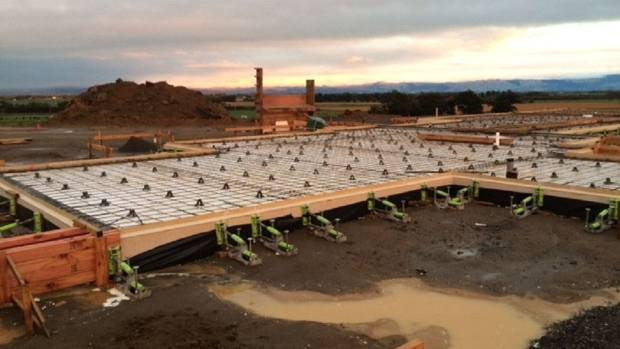 """Steel mesh being laid in the concrete foundations of Jackie's $700,000 """"dream home""""."""
