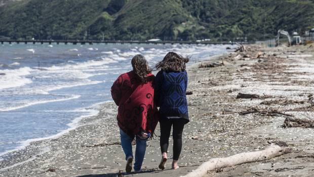 Lynne Russell on Petone Beach with her 21-year-old daughter, who has attempted suicide on several occasions.
