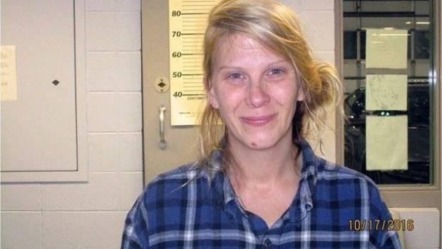A woman has been arrested after allegedly smearing peanut butter on 30 cars parked outside what she believed was a ...