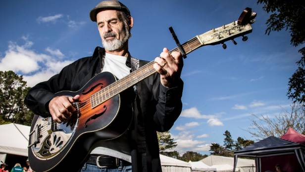 """Frank John, from New Plymouth, with his Gretsch resonator guitar. He said of the festival: """"We know most of these people ..."""