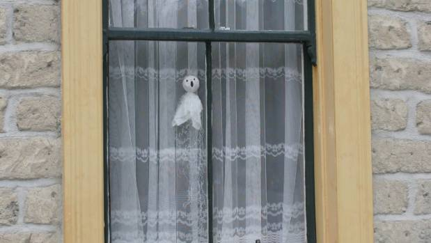 """A """"ghost"""" hangs in the window of Room 1 at the Vulcan Hotel."""