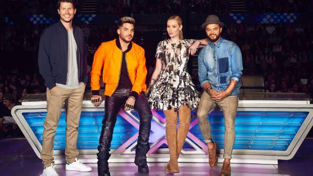 X Factor Australia host Jason Dundas (left) with judges Adam Lambert, Iggy Azalea and Guy Sebastian.