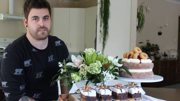 Baker Gatherer Dane McGregor with his inventions, which include s'mores brownies and a cream donut cake.