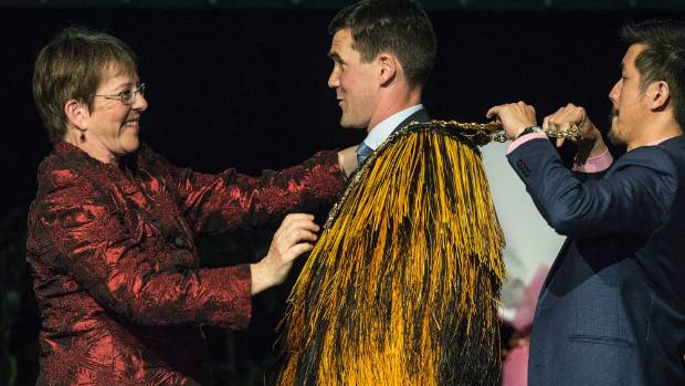 Former Wellington Mayor Celia Wade-Brown passes the city's mayoral chains to its new leader, Justin Lester, at the ...